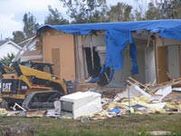 Mobile home being bulldozed